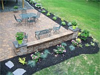 Patio With Sitting Wall and Flowerbed
